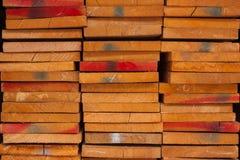 Pila de madera mantenida la acción para la venta Foto de archivo libre de regalías