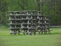 Pila de mesas de picnic fotografía de archivo