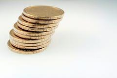 Pila de monedas de un oro del dólar Fotos de archivo libres de regalías
