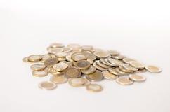Pila de monedas euro en el fondo blanco Imagen de archivo libre de regalías