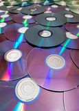 Pila de muchos Cdes o de DVDs Imagen de archivo