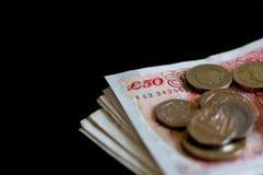 Pila de negocio y de finanzas del gbp de la libra esterlina de británicos del dinero Fotos de archivo libres de regalías