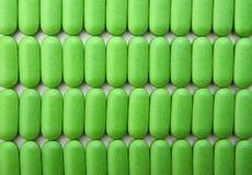 Pila de píldoras verdes foto de archivo libre de regalías