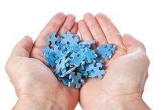 Pila de palmas de los rompecabezas. Fotos de archivo