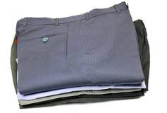 Pila de pantalones formales fotos de archivo