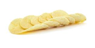 Pila de patatas fritas en el fondo blanco Imagenes de archivo