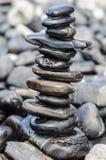 Pila de piedras en la playa del nam de Hin, Lipe, Tailandia Imágenes de archivo libres de regalías