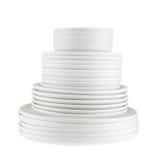 Pila de placas blancas limpias del plato aisladas Fotos de archivo