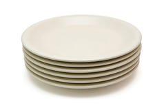 Pila de placas de cena amarillentas Imagenes de archivo
