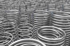 Pila de primaveras y de bobinas del metal Imagen de archivo
