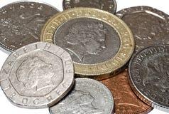 Pila de primer de las monedas de británicos Imagenes de archivo