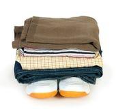 Pila de ropa en los zapatos Foto de archivo libre de regalías