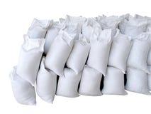 Pila de sacos blancos por completo con la arena y la roca Imagen de archivo libre de regalías