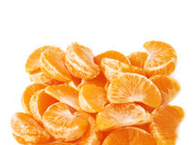Pila de secciones de la rebanada de la mandarina aisladas encima Fotografía de archivo
