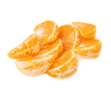 Pila de secciones de la rebanada de la mandarina aisladas encima Foto de archivo libre de regalías