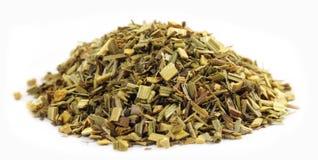 Pila de té verde con la hierba de limón imagen de archivo