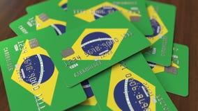 Pila de tarjetas de crédito con la bandera del Brasil Animación conceptual 3D del sistema bancario brasileño almacen de video