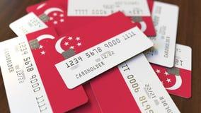 Pila de tarjetas de crédito con la bandera de Singapur Animación conceptual 3D del sistema bancario singapurense almacen de metraje de vídeo