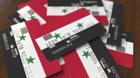 Pila de tarjetas de crédito con la bandera de Siria Animación conceptual 3D del sistema bancario sirio almacen de metraje de vídeo