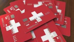 Pila de tarjetas de crédito con la bandera de Suiza Animación conceptual 3D del sistema bancario suizo almacen de metraje de vídeo