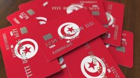 Pila de tarjetas de crédito con la bandera de Túnez Animación conceptual 3D del sistema bancario tunecino metrajes