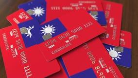 Pila de tarjetas de crédito con la bandera de Taiwán Animaci?n conceptual 3D del sistema bancario taiwan?s almacen de metraje de vídeo