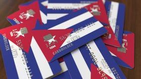 Pila de tarjetas de cr?dito con la bandera de Cuba Animación conceptual 3D del sistema bancario cubano almacen de metraje de vídeo