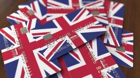 Pila de tarjetas de cr?dito con la bandera del Reino Unido Animación conceptual 3D del sistema bancario británico ilustración del vector