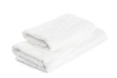 Pila de toallas blancas aisladas Imagenes de archivo