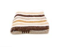 Pila de toallas coloreadas arco iris aisladas fotografía de archivo