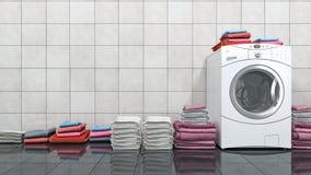 Pila de toallas coloridas en la lavadora Imágenes de archivo libres de regalías