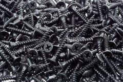 Pila de tornillos de madera negros Imagen de archivo