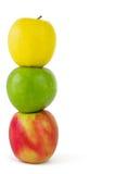 Pila de tres manzanas coloridas Imagen de archivo libre de regalías