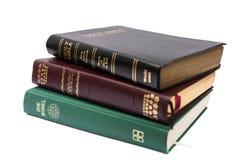 Pila de tres Sagradas Biblias Imagen de archivo libre de regalías