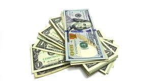 Pila de un billetes de dólar y de cientos cuentas Imagen de la foto Foto de archivo libre de regalías