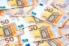 Pila de uso euro de muchos cincuenta billetes de banco para el dinero o la parte posterior de la moneda Fotografía de archivo