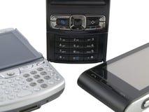 Pila de varios teléfonos móviles modernos en blanco fotos de archivo libres de regalías