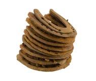 Pila de zapatos retros viejos del caballo aislados en blanco Imagen de archivo libre de regalías