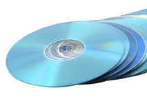 Pila del Blu-raggio di DVDs dei Cd di dischi su bianco Immagini Stock