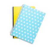 Pila del cuaderno en el fondo blanco Imagen de archivo libre de regalías