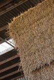 Pila del heno en granero Foto de archivo libre de regalías