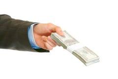 Pila della holding della mano dell'uomo di dollari. Primo piano. Fotografie Stock Libere da Diritti