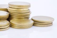 Pila della moneta di oro Immagine Stock