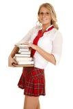 Pila della ragazza della scuola di sorridere dei libri Fotografia Stock Libera da Diritti