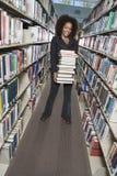 Pila della tenuta della donna di libri Fotografia Stock