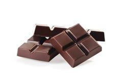 Pila delle barre di cioccolato isolata su bianco Fotografia Stock Libera da Diritti