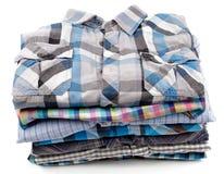 Pila di camice degli uomini del plaid Fotografia Stock