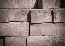 Pila di ciottoli della pavimentazione, mattoni struttura vignetted, costruzione immagine stock libera da diritti