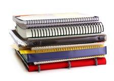 Pila di dispositivi di piegatura, libri, copybooks Fotografia Stock