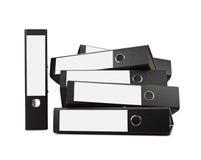 Pila di dispositivi di piegatura neri dell'ufficio Fotografie Stock